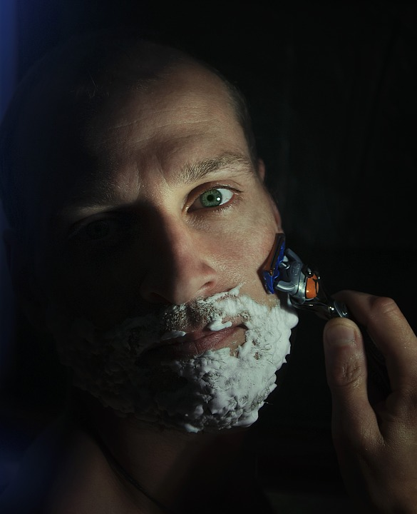 image of a man shaving