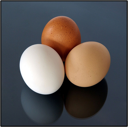 three eggs of different colors
